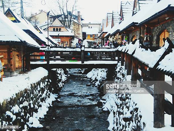 Bridge Over Canal In Town During Winter
