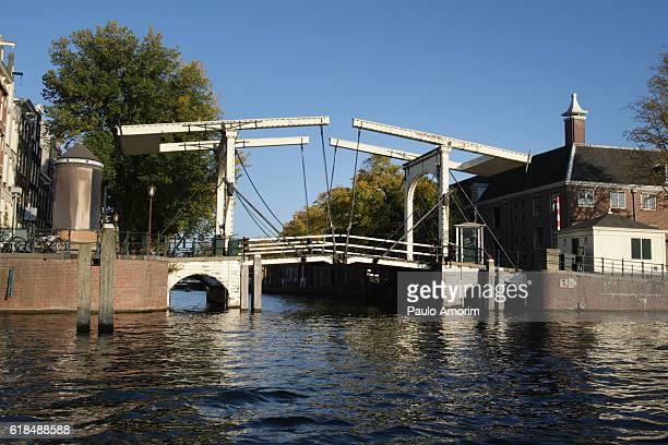 Bridge over canal with Amstel River in Amsterdam