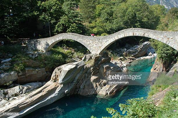 bridge over green water - locarno stock photos and pictures
