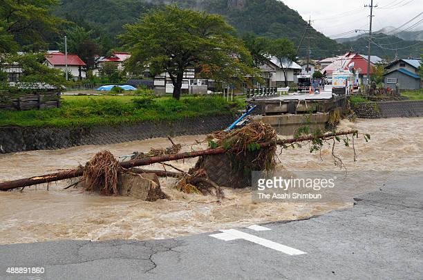A bridge over Hisawagawa River is washed away after torrential rain on September 10 2015 in Minamiaizu Fukushima Japan