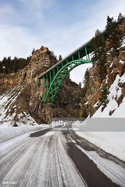 bridge over icy road,  colorado,  usa - thinkstock stock photos and pictures