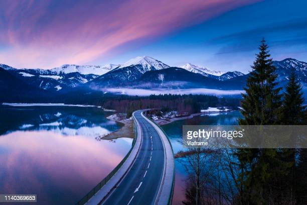 bridge over lake in germany - bavaria stock pictures, royalty-free photos & images