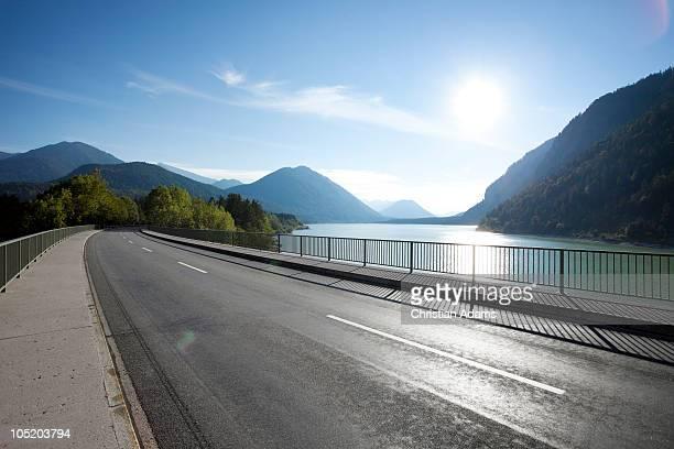 Bridge over lake in sunset