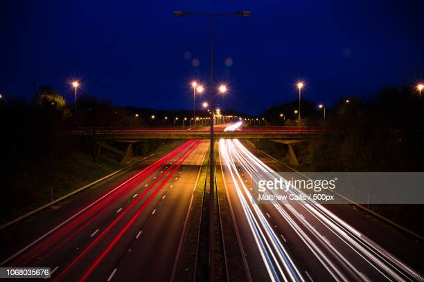 bridge over motorway at night, loughborough, leicestershire, uk - loughborough stock pictures, royalty-free photos & images