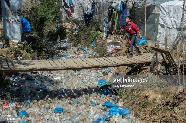 A bridge over plastic waste on March 12 2020 in Mytilene Greece The Moria Refugee Camp near Mytilene on the Island of Lesvos is extremely overcrowded...