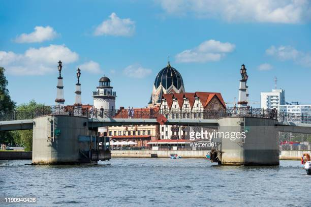 bridge over pregel river against sky at kaliningrad, russia - russia stock pictures, royalty-free photos & images