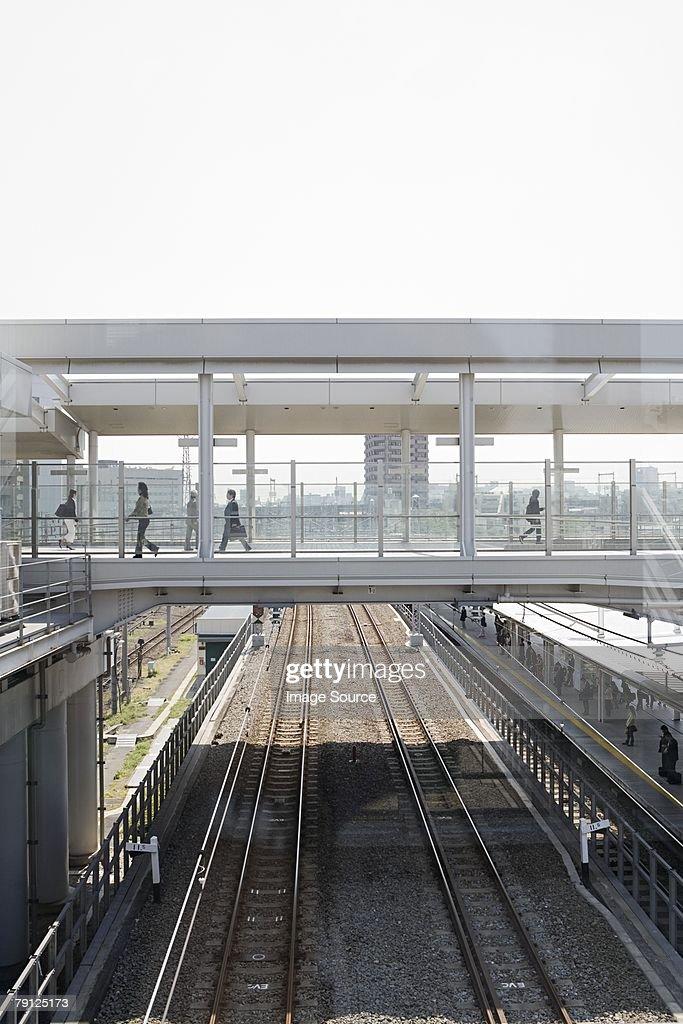 Bridge over railway tracks : Stock Photo