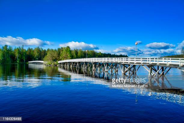 bridge over river against blue sky - jyväskylä stock pictures, royalty-free photos & images