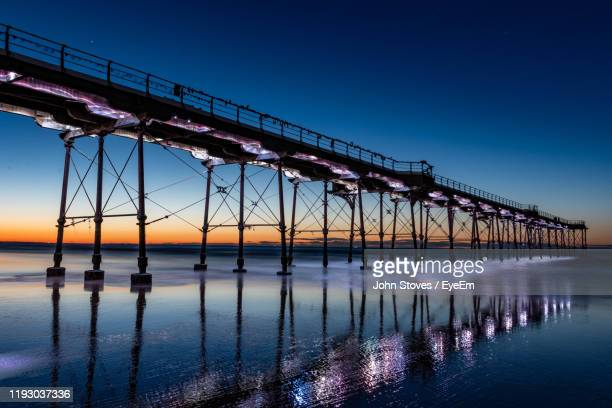 bridge over river against blue sky - saltburn stock pictures, royalty-free photos & images