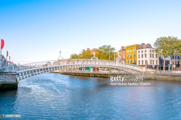 bridge over river against buildings in city - famous place stock pictures, royalty-free photos & images