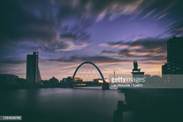 bridge over river against buildings in city - river clyde stock pictures, royalty-free photos & images
