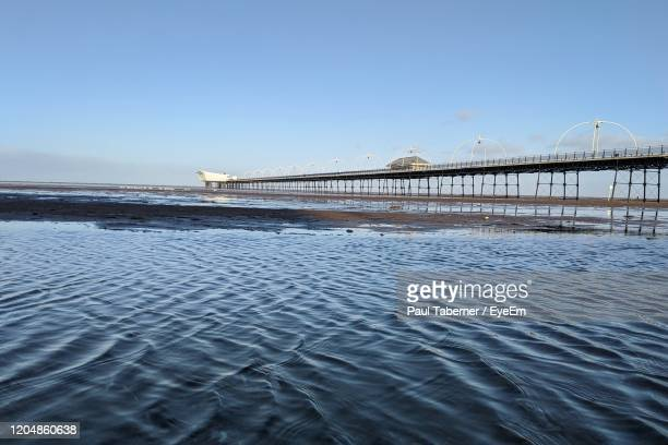bridge over river against clear blue sky - southport england stock pictures, royalty-free photos & images