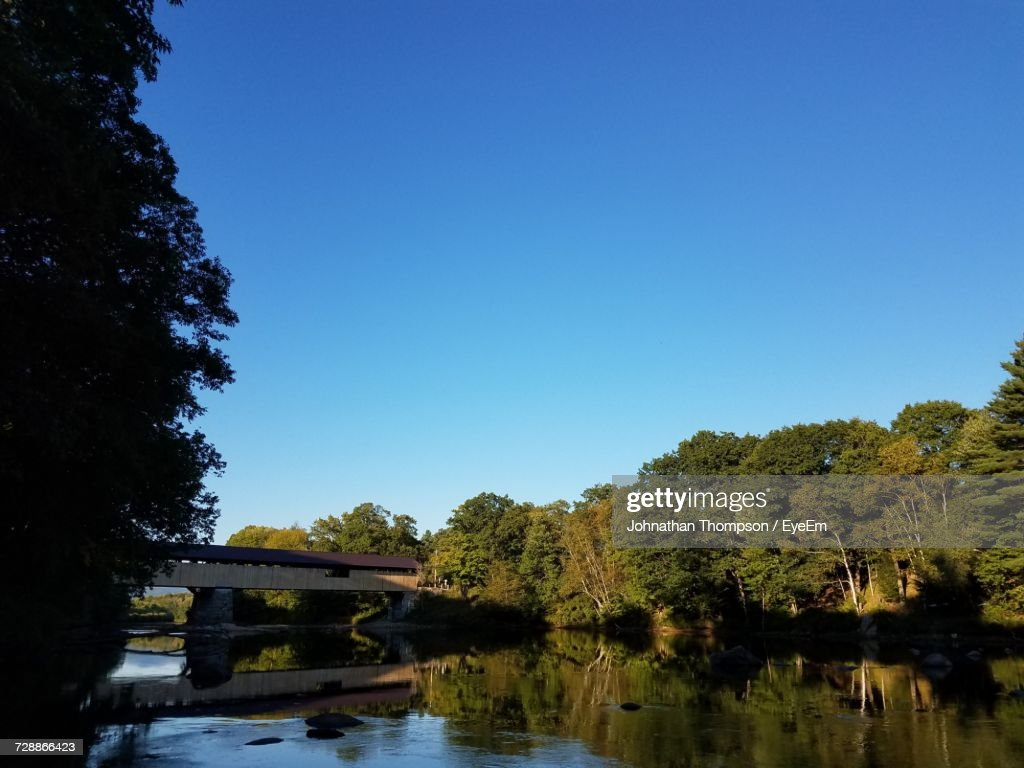Bridge Over River Against Clear Blue Sky : Stock Photo