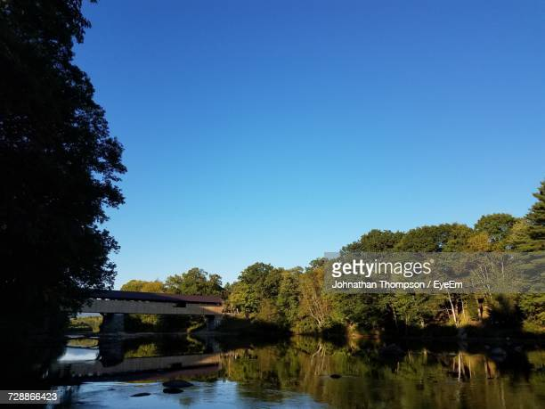 bridge over river against clear blue sky - plymouth massachusetts stock photos and pictures