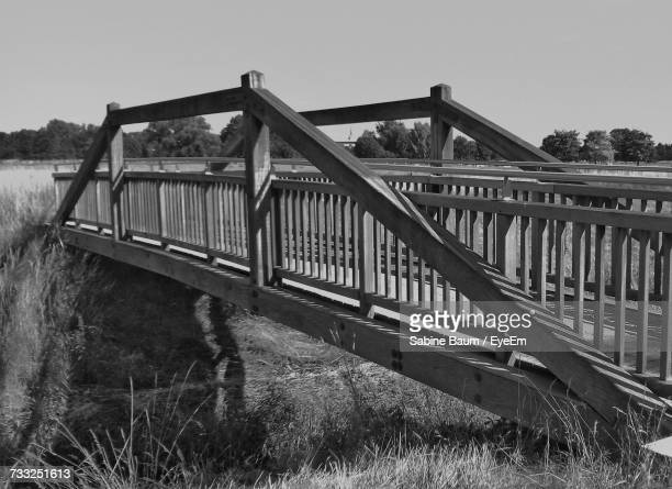 bridge over river against clear sky - baum stock pictures, royalty-free photos & images