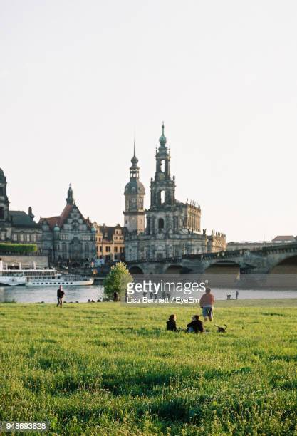 bridge over river against clear sky - dresden stock pictures, royalty-free photos & images