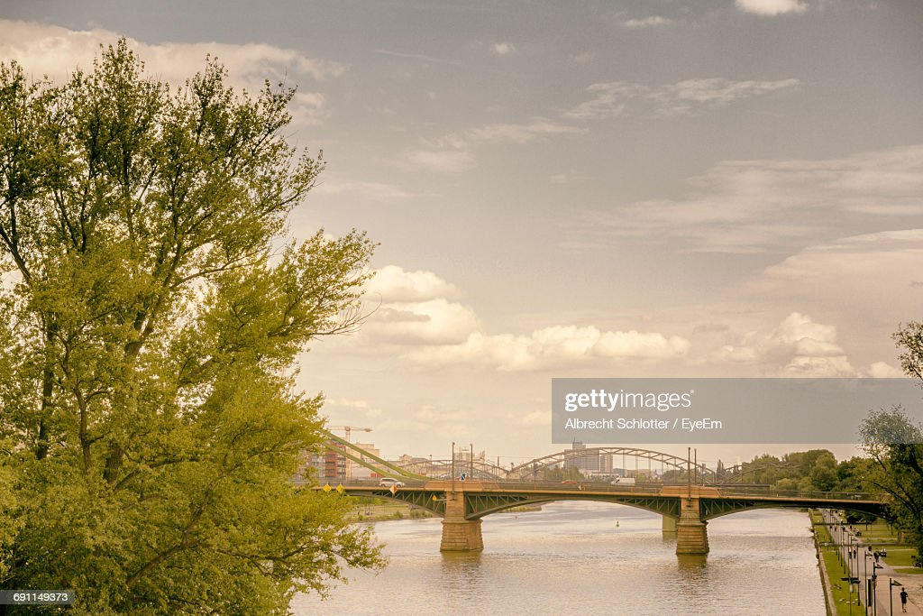 Bridge Over River Against Cloudy Sky : Stock Photo