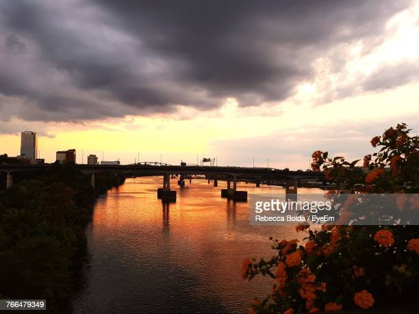 bridge over river against cloudy sky - shreveport stock pictures, royalty-free photos & images