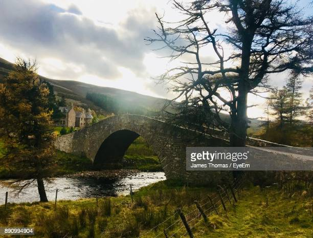 bridge over river against cloudy sky - aberdeenshire stock pictures, royalty-free photos & images