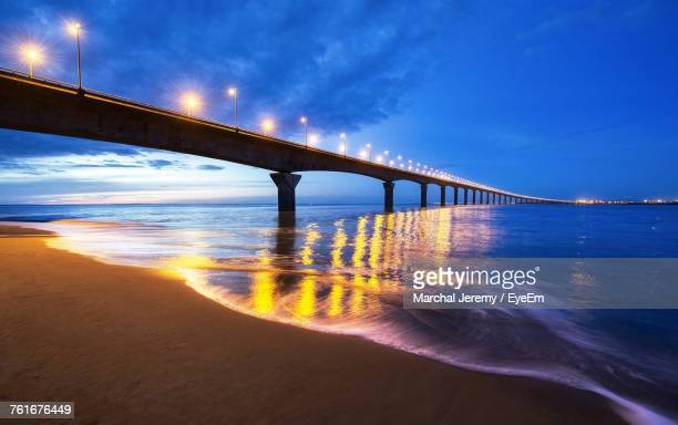 bridge over river against sky at night - la rochelle stock pictures, royalty-free photos & images