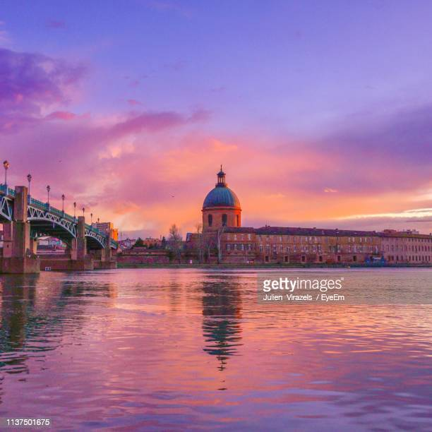 bridge over river against sky at sunset - toulouse stock pictures, royalty-free photos & images