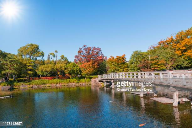 bridge over river against sky during autumn - nagoya stock pictures, royalty-free photos & images