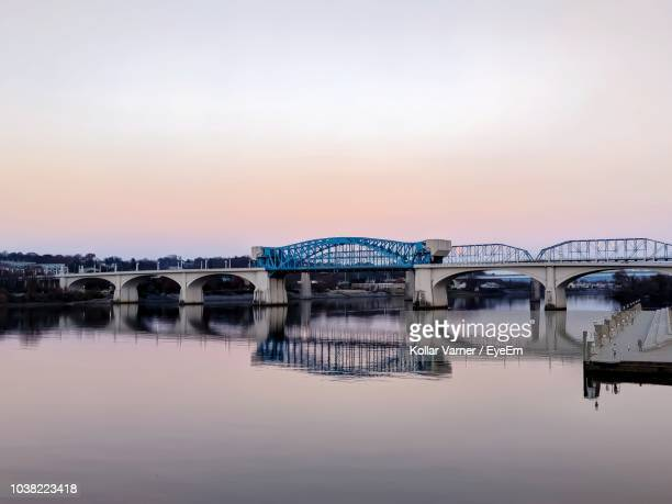bridge over river against sky during sunset - chattanooga stock pictures, royalty-free photos & images