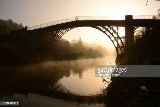 bridge over river against sky during sunset - ironbridge shropshire stock pictures, royalty-free photos & images