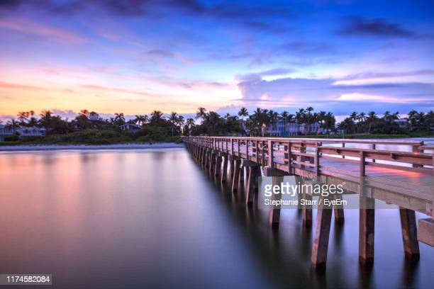 bridge over river against sky during sunset - naples florida stock pictures, royalty-free photos & images