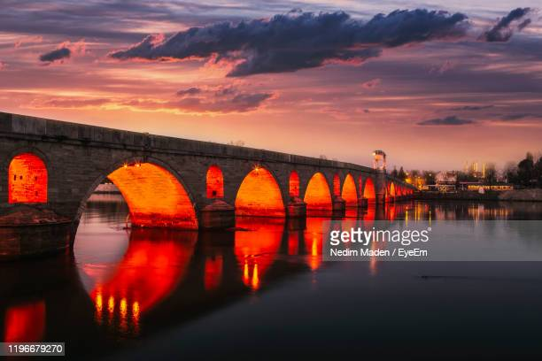 bridge over river against sky during sunset - edirne stock pictures, royalty-free photos & images