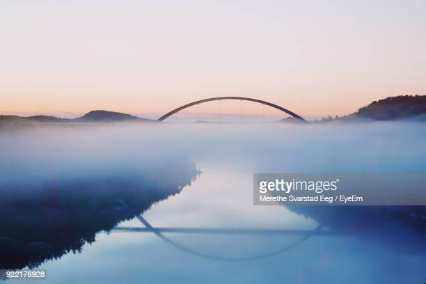 bridge over river against sky during sunset - bridge stock pictures, royalty-free photos & images