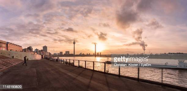 bridge over river against sky in city during sunset - düsseldorf stock pictures, royalty-free photos & images
