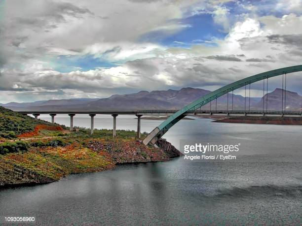 bridge over river against sky - angele florisi stock pictures, royalty-free photos & images