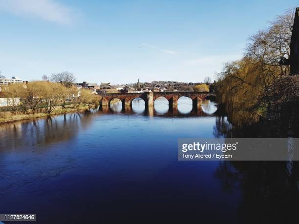 bridge over river against sky - dumfries stock pictures, royalty-free photos & images