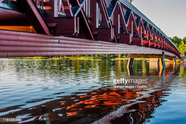 bridge over river against sky - vaxjo stock pictures, royalty-free photos & images