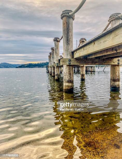 bridge over river against sky - kelowna stock pictures, royalty-free photos & images
