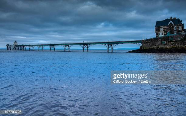 bridge over river against sky - clevedon pier stock pictures, royalty-free photos & images