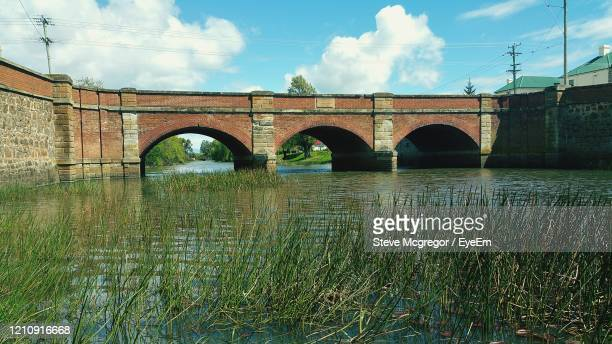 bridge over river against sky - mcgregor stock pictures, royalty-free photos & images
