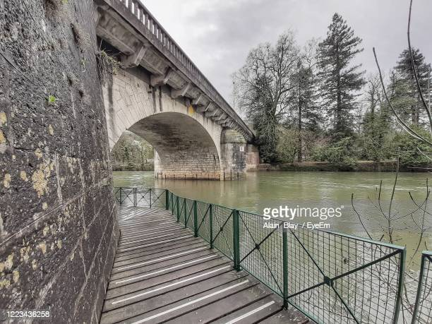 bridge over river against sky - charente stock pictures, royalty-free photos & images