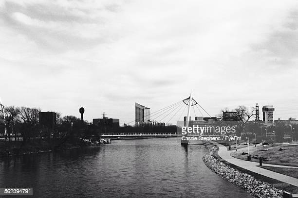 bridge over river against sky - wichita stock pictures, royalty-free photos & images