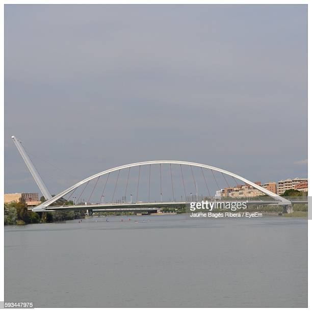 bridge over river against sky - transferbild stock-fotos und bilder