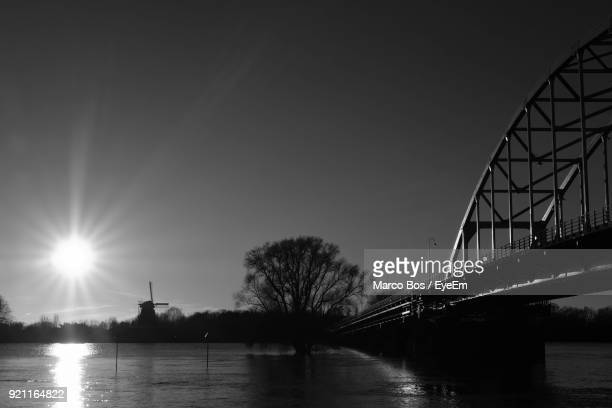 bridge over river against sky - bos stock pictures, royalty-free photos & images