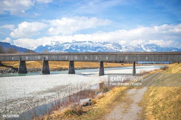 bridge over river against sky - vaduz stock pictures, royalty-free photos & images