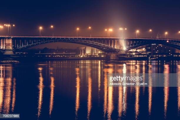 bridge over river at night - albrecht schlotter stock photos and pictures