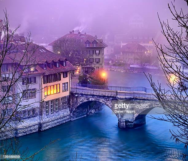 Bridge over river at sunrise in Bern