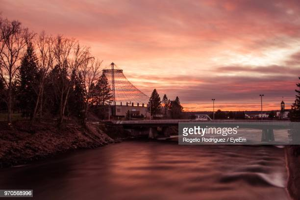 bridge over river at sunset - riverfront park spokane stock photos and pictures