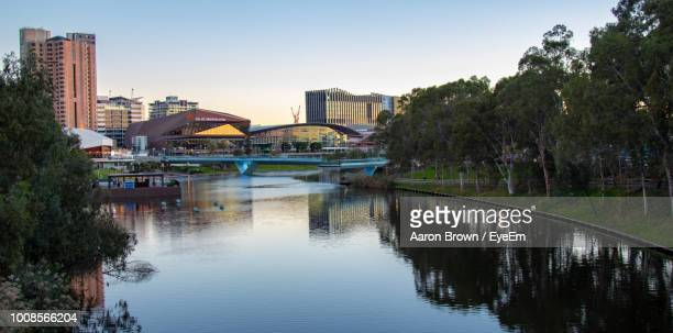 bridge over river by buildings against clear sky - adelaide stock pictures, royalty-free photos & images