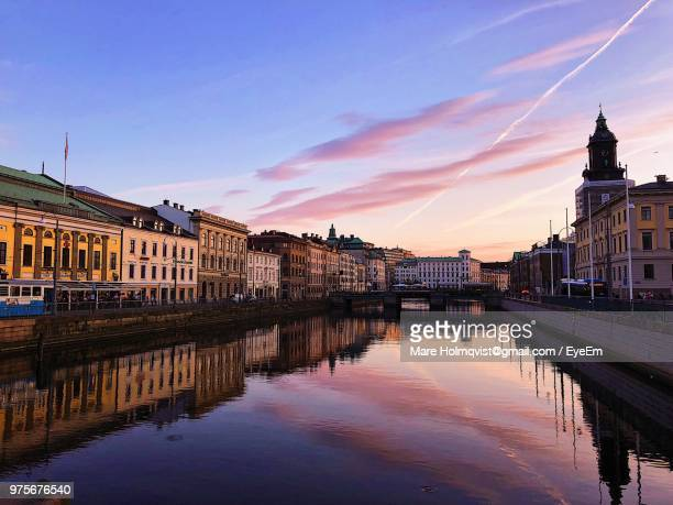 bridge over river by buildings against sky at sunset - gothenburg stock pictures, royalty-free photos & images
