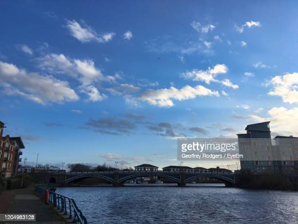 bridge over river by buildings against sky in city - stockton on tees stock pictures, royalty-free photos & images