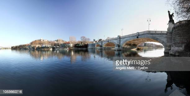 bridge over river by buildings against sky - turin stock pictures, royalty-free photos & images